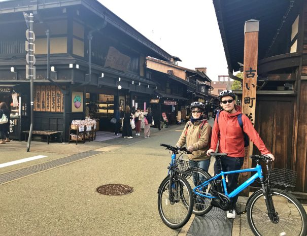 Bike travelers at the famous street in Takayama