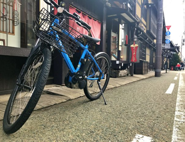 A blue electric bike at the traditional street in Takayama