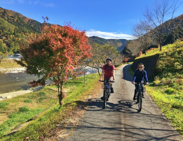 European guests enjoying cycling in the field of countryside in Japan