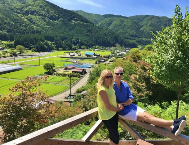 European travelers relaxed at the observation deck of the rural village of Takayama