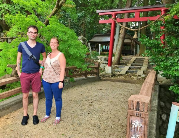 Irish guests standing in front of the local shrine in Takayama area