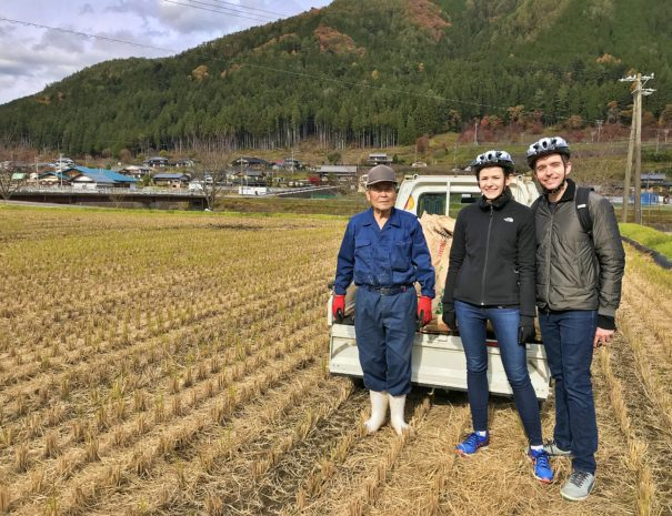 US guests with a Japanese farmer in the rice field