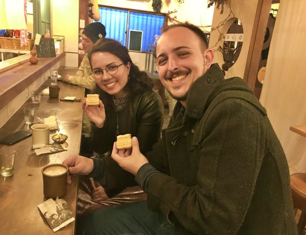 A couple from US holding traditional Japanese sweets at the local cafe in Gero