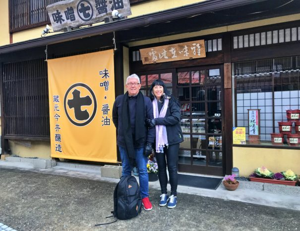 Australian guests smiling in front of the Miso brewery in Hida