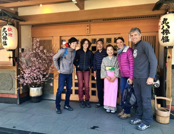 Cycling tourists taking a photo at the Japanese traditional Ryokan