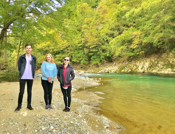 Australian family standing by the beautiful Maze river in Hida