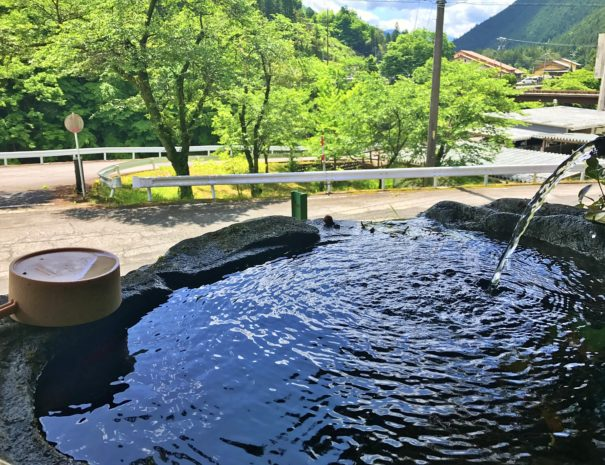 Water slowly flowing at the Japanese local shrine