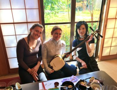 French tourists holding Japanese Shamisen by the professional