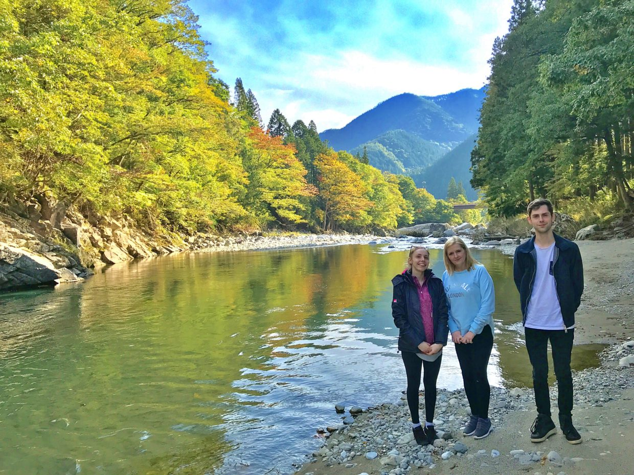 Australian family standing by the beautiful river