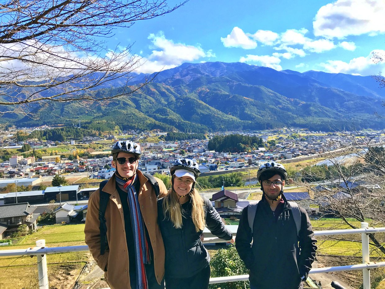 Foreign tourists smiling in front of the beauty of Japan