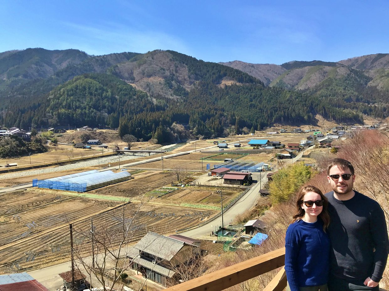 UK tourists standing on the observation deck in the rural village of Takayama